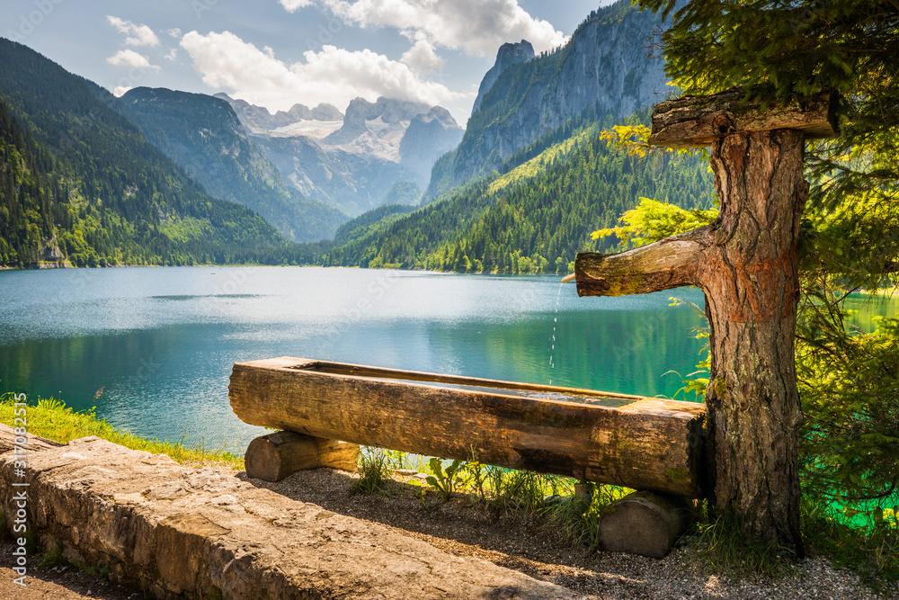 Fototapeta Drinking basin by Gosausee lake, Dachstein behind