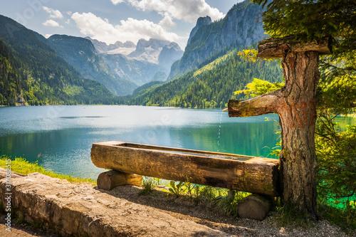 Fototapeta Drinking basin by Gosausee lake, Dachstein behind obraz