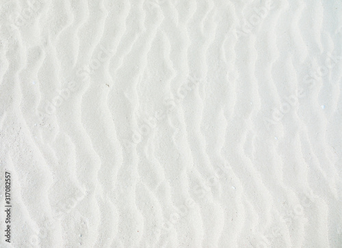 Photo waves of white sand background