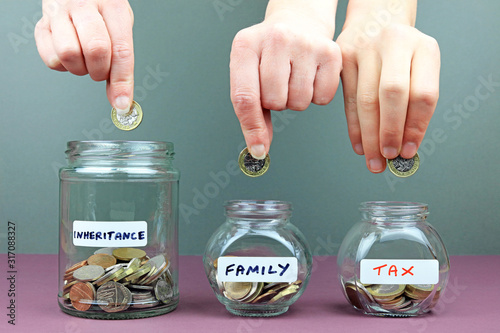 Cuadros en Lienzo Hands putting in to different money jars