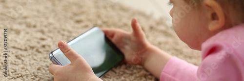 Little hacker girl of generation z using mobile phone for entertain oneself from Fototapet