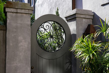 A Round-top Door With A Wrough...