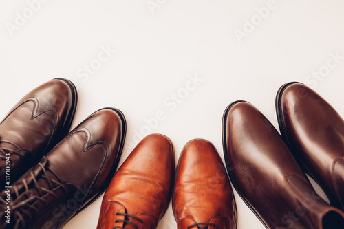 Shoes, three pairs of stylish leather boots for men. Male winter, autumn or spring fashion. Footwear. Sale