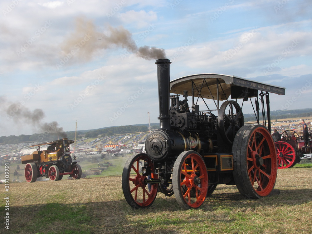 Fototapeta two historical steam engines  at a hill at the dorset steam fair in england