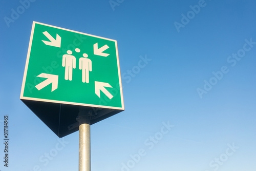 outdoor sign in Germany for a meeting point isolated against the sky.