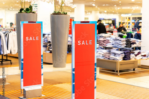 Fotografía Red bright sale word banner on anti-thieft gate sensor at retail shopping mall entrance