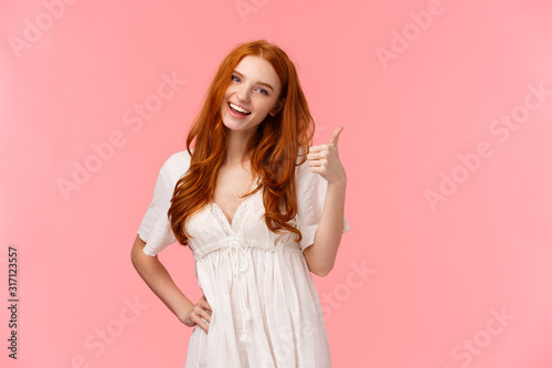 Photo Confident good-looking redhead optimistic girl, saying everything be alright, al