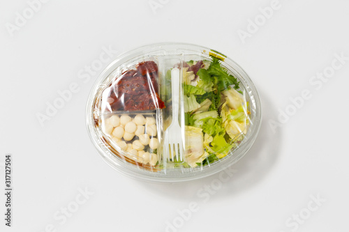 Use less plastic! Food in plastic packaging isolated on white ground Fototapete