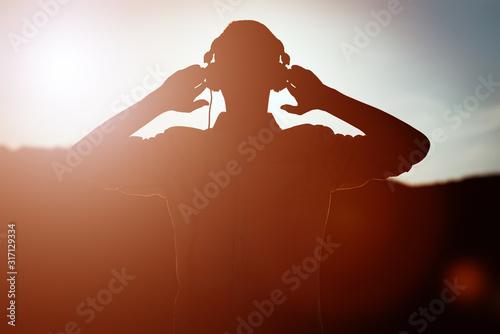 stylish bearded man in headphones listening to music Canvas Print