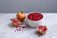 Pomegranate Seeds In A White C...