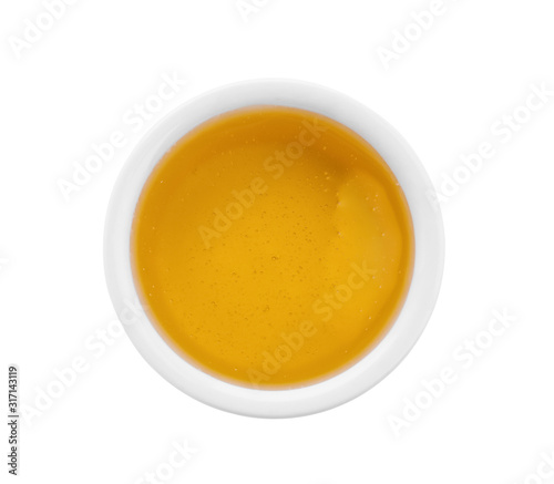 Bowl of organic honey isolated on white, top view Wallpaper Mural