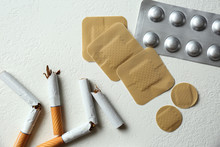Nicotine Patches, Pills And Broken Cigarettes On White Background, Flat Lay
