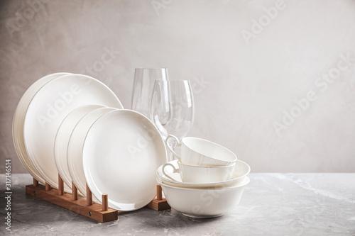 Fototapeta Set of clean dishware on marble table obraz