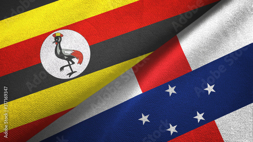 Uganda and Netherlands Antilles two flags textile cloth, fabric texture Canvas Print