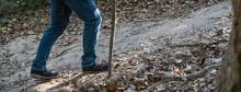 Traveler Feet In Trekking Boots On Mountain Dirty Path.