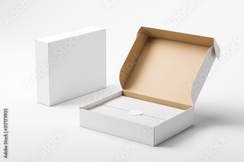 Slika na platnu Open and closed white realistic cardboard box with paper and a sticker on a light background
