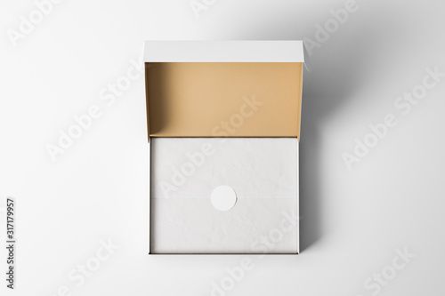 Obraz Top view of an open white realistic cardboard box with wrapping paper and a sticker on it. The concept of business gifts. Mock up. 3d rendering - fototapety do salonu