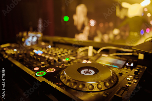 DJ Spinning, Mixing, and Scratching in a Night Club, Hands of dj tweak various t Wallpaper Mural