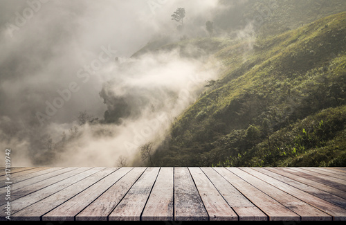 Fototapeta Old wood desk or wood floor with landscape mountain views for products display