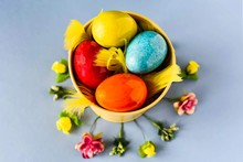 Colored Easter Eggs In A Yello...