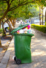 Green Waste Bins In The Park With Garbage-tight Waste And Defective Conditions