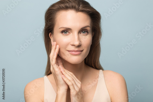 Portrait of beautiful woman touch healthy clean skin - 317201310