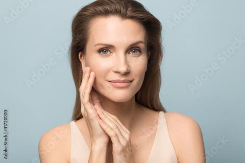 Valokuvatapetti Portrait of beautiful woman touch healthy clean skin