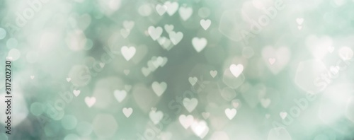 abstract-background-with-bokeh-and-green-hearts