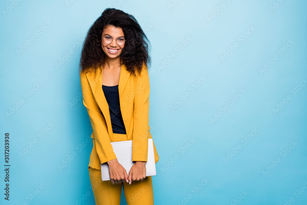 Fototapeta Photo of pretty dark skin wavy business lady holding notebook friendly work atmosphere visit corporate training wear specs yellow suit blazer pants isolated blue color background