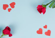 canvas print picture - Red roses and red hearts on a blue background.