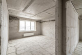 Empty interior for design, gray concrete wall. Empty room. Space for text and picture. Concrete walls, slabs, interior of a new residential building. Partitions in a new apartment.