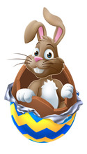 The Easter Bunny Breaking Out Of A Chocolate Easter Egg Cartoon