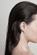 Leinwanddruck Bild - profile of young woman with long dark  wet hair natural beauty concept