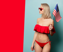 Beautiful Blonde Woman In Bikini With USA Flag