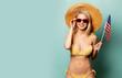 Beautiful blonde woman in bikini with flag of USA