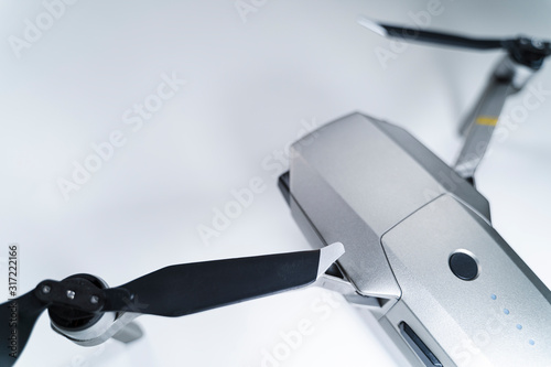 Photo quadrocopter drone on a white table