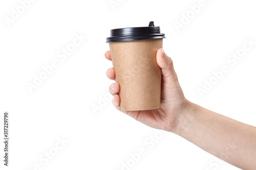 Obraz Hand holding a cup isolated on white background. - fototapety do salonu