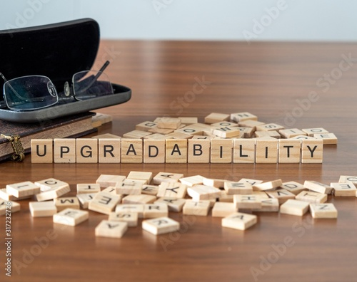 upgradability concept represented by wooden letter tiles Canvas Print