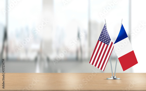 American and French Flags are Paired Together At Office Desk Canvas Print