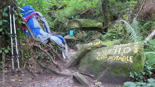 Fotografie, Tablou Hiking backpack and yellow signs of drink potable water write on a rock, Norther