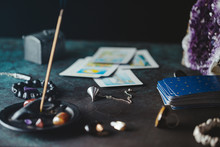 Tarot Cards Are Surrounded Magic Things On A Table.Mystical And Occult Concept.