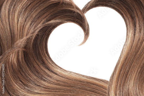 Fotografering Brown hair in shape of heart on white, isolated