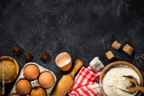 Ingredients for cooking baking on black. Wallpaper Mural