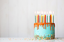 Birthday Cake With Candles And Drip Icing