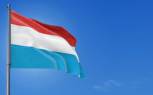 Luxembourg Flag Waving In The Wind Against Deep Blue Sky. National Theme, International Concept. Copy Space For Text.