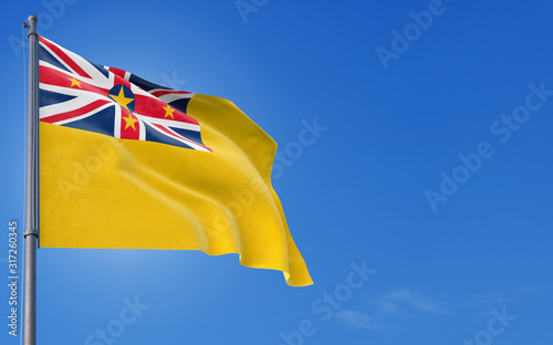 Niue flag waving in the wind against deep blue sky Canvas Print