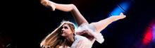 Panoramic Shot Of Flexible Girl In Costume Performing In Arena Of Circus
