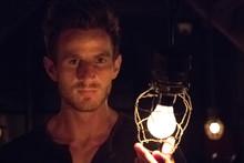 Man Holding Vintage Light