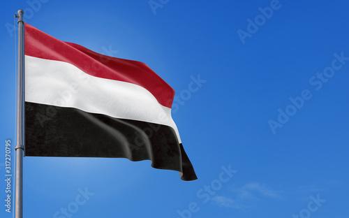 Yemen flag waving in the wind against deep blue sky Canvas Print