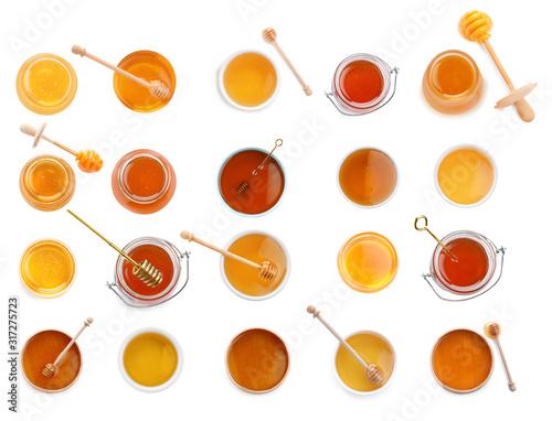 Photographie Set of organic delicious honey on white background